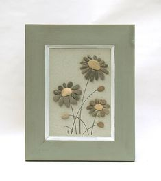 Decorations made of natural stone from the Danube riverside - river pebbles. This listing is for one framed picture made of natural rocks - in form of flowers. Frame with stone paint. This is a very nice pebble art that perfectly suits as a gentle decoration, wall 3D decor. It will