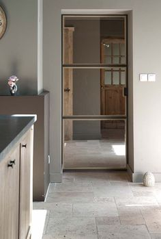 Glass doors are too little used indoors, yet the quiet operation and tight fit that modern versions offer enable them to serve as effective barriers to smell and sound even as they visually open space.