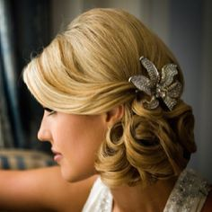 clean side-do with curls tucked in/swept bangs/broach accessory