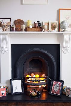 Brighton home buys by What Katie Does, via Flickr.  I need a fireplace and the Cable & Cotton lights