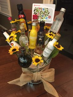 A 21st birthday bouquet! Created using mini bottles of alcohol, skewer sticks, a hot glue gun, some fake flowers, a Styrofoam bottom and a tin bucket! So easy and such a fun gift!