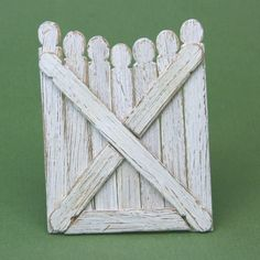 Miniature picket gate made from coffee stir sticks