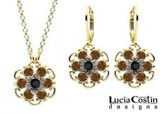 Lucia Costin Pendant and Earrings Set Made in 24K Yellow Gold Plated over .925 Sterling Silver with Twisted Lines, Black and Brown Swarovski Crystals, Enhanced with Sterling Silver Center Flowers Lucia Costin. $110.00. Style takes wings in this lovely jewelry set that have a graceful flower shape. Lucia Costin floral jewelry set. Handmade in USA unique jewelry set. Flowers and fancy ornaments beautifully combined. Amazingly designed with black and brown Swarovski crystals