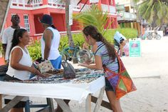 Negotiating for a fair price at San Pedro, Belize C.A