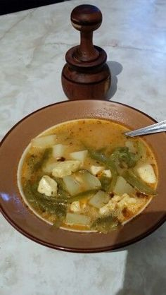 Caldo de Queso, comida sonorense:  papas, queso, chile verde en rajas o cortado en pedasos pequenos, leche, oregano, sal, pimiento, cebolla, un tomate y agua.