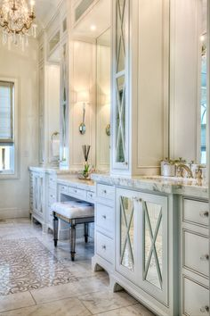 master bath with calcutta gold marble and Ann sacks inlay. Paint color is Benjamin Moore white dove.
