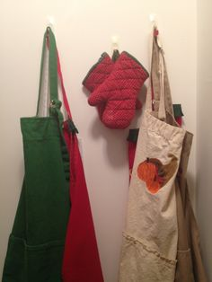 Aprons are easily kept on a hook on the back of a door or pantry wall. A Hook, Wall Organization, Aprons, Pantry, Organizing, Burlap, Reusable Tote Bags, Pantry Room, Butler Pantry