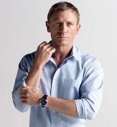 Daniel Craig. Blue oxford and watch