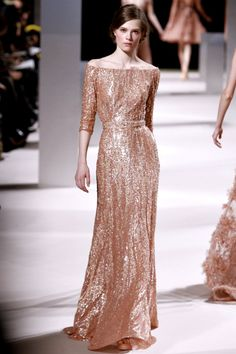 Elie Saab. This reminds me of the sparkly version of Kate Middleton's purple dress she wore in California. Beautiful both ways.