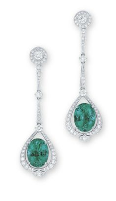 A PAIR OF EMERALD AND DIAMOND EAR PENDANTS  EACH SUSPENDING AN OVAL-SHAPED EMERALD WEIGHING APPROXIMATELY 4.03 AND 3.83 CARATS, WITHIN A BRILLIANT-CUT DIAMOND PEAR-SHAPED FRAME, TO THE BRILLIANT-CUT DIAMOND SURMOUNT, WITHIN A BRILLIANT-CUT DIAMOND SURROUND, JOINED BY SIMILARLY-CUT TAPERED BAR-LINKS AND SPACERS, MOUNTED IN 18K WHITE GOLD, 5.2 CM LONG