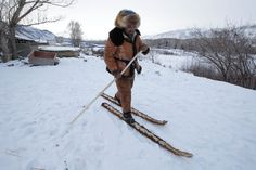 skies covered with horsehide  Local craftsman Slanbek, 63, tests traditional horsehide skis outside his house on the outskirts of Altay, in China's Xinjiang Autonomous Region. [Jason Lee/Reuters]