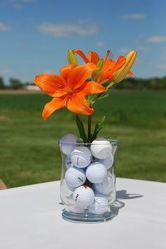 I like the idea of putting golf balls at the bottom of the vase for centerpieces