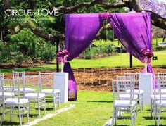 Purple draped wedding arch.  L.O.V.E <3