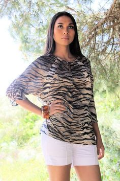 https://www.cityblis.com/5715/item/9270   Kimono Shirt - $40 by JOANA ALMAGRO   Spring and Summer 2013- Summer Fabulous collection. Inspirations from Japanese kimono in animal prints and black beads. Your perfect summer shirt for this season. The front shirt is made of 85% Satin Polyester in tiger print and 15% Silk with combination of printed %100 Chiffon lace. This Kimono can...   #Tops/Blouses
