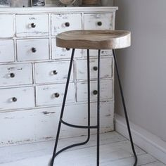 Scandinavian Bar Stool - This weathered wooden bar stool has solid seat carved for comfort and elegant aged metal legs.