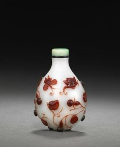 A red overlaid glass snuff bottle decorated with gourds and butterflies. Possibly Imperial, Palace Workshops,