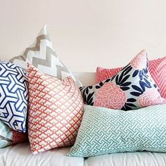 i love the idea of white walls and then pulling in all the color with the pink, blues, etc!   pink and navy throw pillow inspiration-perfect color sceme- gray, navy, pale pink