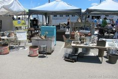 Nashville Flea Market - I love the red stripe buckets. I would hold blankets to the side of a couch or hold fabric rolls by my sewing machine.