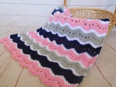 Pink, grey and navy. This is a very special handmade crochet baby blanket.  This baby afghan will make a wonderful baby shower gift.  This blanket would make a lovely addition to your baby nursery decor. Perfect also, for travel, strollers, prams, cribs, tummy time and photo props