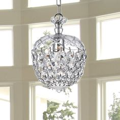 Illuminate your home in style with this simple and dazzling crystal chandelier. This crystal lighting fixture will bring radiant warmth to your home.