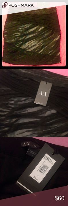 Armani Exchange mini skirt in black size 4 Super chic Armani exchange skirt with sheer tool overlaying nude. Perfect with any top and a pair of heels. Let me know if you have any questions. Armani Skirts Mini