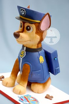 "Paw Patrol Chase Dog Cake - This is a puppy called Chase from a newish TV show called Paw Patrol.   I followed Elisa Strauss' Sculpted Dog Cake Craftsy class for carving and structure help. The body is all cake, but I carved the head and hat from styro.  He is over a foot and a half tall, and sits on a 16"" board.  If I make this cake again, I will charge ten million dollars. :-)"