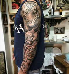 Pin by kevin klatt on mens rose tattoos tattoos, sleeve tattoos, lion tatto Tiger Tattoo Sleeve, Lion Tattoo Sleeves, Arm Sleeve Tattoos, Clock Tattoo Sleeve, Bicep Tattoo Men, Rose Tattoos For Men, Tattoos For Guys, Animal Tattoos For Men, Geniale Tattoos