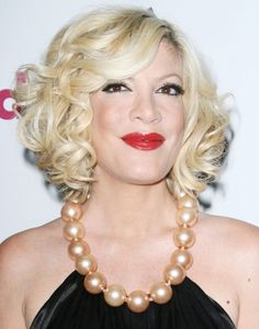 Tori Spelling wears a romantic ringlets hairstyle
