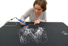 Sofia Björkman making jewellery using a 3D pen.