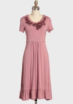 """SHARE  emma rosette indie dress  $59.99    Size    QTY       size chart size chart    Embellished with delicate raw-edged rosettes, this ever-so soft jersey dress in mauve is casually stylish with a ruffled hem, raw edged chiffon accents, and a hint of stretch for a comfortable and flattering fit. Finished in a longer length with a subtle kiss of glowing sheen for a look that exudes modern romance.    95% Rayon, 5% Spandex  Imported  43"""" length from top of shoulders"""