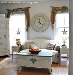 Fall Home Tour - the Family Room with landscape burlap swags over branches for curtain rods