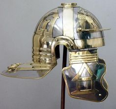 Mainz helmet, closeup, showing brass applique of eagles and temples