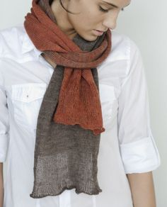 Decalage from Julie Hoover: Using three strands of delicate Habu fine merino, this modern and stylish scarf is an experiment in blending color as it shifts gradually from one to a another. Each end of the scarf brings in a strand of silk stainless steel, creating a difference in shape and texture.  You will need 2 cones of Color A and 2 cones of Color B of Habu Super Fine Merino, 1 cone of Color A and 1 cone of Color B in Habu Silk Stainless Steel, US 5 needles OR size needed to obtain…