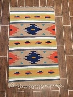 # KIL2 This is a Kilim Rug with very nice decorative colors. Hand made in India. Size 3 feet x 5 feet ( size may vary in inches. A couple of inches longer or shorter as its hand made) 100 % wool and e