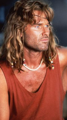 Kurt Russell - Captain Ron One of my husbands favorite movies.