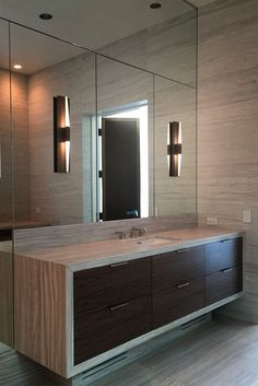 Brass Lighting: This bathroom by Laura Lee Clark Interior Design features the Icicle Wand Sconce in Blackened Brass. Sconce designed by Tom Nahabedian for Boyd Lighting.