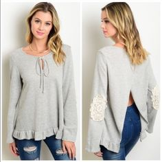 """GREY RUFFLE HEM CROCHET ACCENT SPLIT BACK TUNIC That's a mouthful!  Love this top!  Tie-able neckline. Ruffle hemline. Textured material of 60% poly and 40% cotton. Totes adorbs crochet accent on the elbows. Open back concept so wear a tank or bandeau or fun bra of your choice!  L26"""" B44"""" W46"""" S - 3 M - 2 L - 1 NO PAYPAL NO TRADES. Due to Poshmark's commission, price is FIRM unless bundled. All sales final. Tops Tunics"""