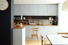 Ice blue kitchen cabinets,Ercol chair, London | Remodelista
