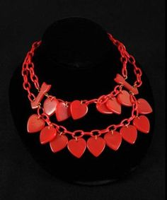 Red Bakelite Heart and Arrow Charms on Celluloid Chain - - Photo Courtesy of Morphy Auctions