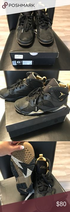 Air Jordan 7 retro. Worn once. Youth 6.5 Air Jordan 7 retro. Worn once. Youth 6.5. Black and gold Jordan Shoes Sneakers