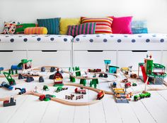 love large car track , I'm thinking 1 track permanently on floor (painted, or just use tape) or glued to floor  the other the children put together some are too young and its frustrating not to complete a circuit