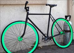 Fixed Gear Bike. Black frame. Green wheels.