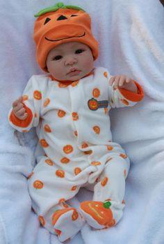 Shyann in pumpkin onsie...