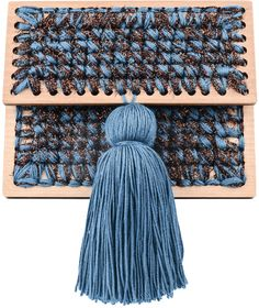 Sparkly brown and ocean blue hand woven'Copacabana' clutch with ocean blue tassel, inside pocket, plywood bottom and frames. 100% microfiber acrylic 100% metallic lurex Height: 13.0 cm Width: 16.5 cm Depth: 7.5 cm Preorder will be shipped in two weeks after the payment has been processed. Handmade in Georgia