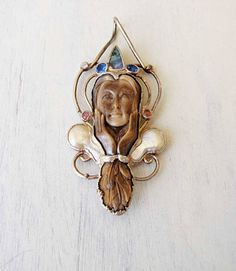 Carved Ancient Fossil Walrus Tusk Woman in Thought Sterling Silver  Sapphires Opal Rose Quartz and Mother of Pearl Pendant