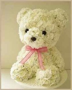 I'm seeing topiary and floral bears at garden centers. The safety eyes and noses are a great addition. Deco Floral, Arte Floral, Floral Design, Flower Boxes, My Flower, Flower Art, Puppy Flowers, Unique Flower Arrangements, Funeral Flowers