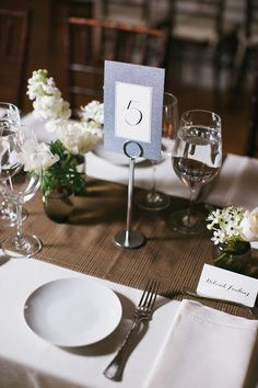 Art Deco table number, photo by Lara Kimmerer http://ruffledblog.com/fall-wedding-massachusetts-art-gallery #weddingideas #tablenumbers