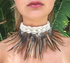 """Crocheted choker with double Cowrie shells and feathers. Hand-made in Bali. Necklace length approximately 11"""" yet may vary slightly due to the hand-made process. Feather length approximately 3-4"""" yet"""