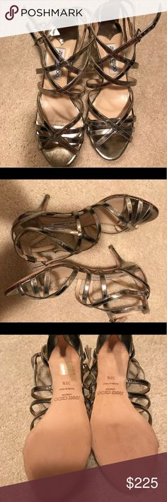 Jimmy Choo Gold Strappy Sandals in 8.5 These Jimmy Choos have been worn maybe twice!! About a two inch heel size 38.5 (8.5). Awesome sandals!! Jimmy Choo Shoes Sandals