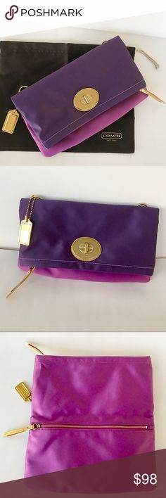 Coach- two toned purple fold clutch purse LIKE BRAND SPANKING NEW. Includes dust bag. Measurements in photos. Beautiful, thick, light and dark purple satin- soft material. Folds in the middle. Is quite large when unzipped and open. Gold hardware. Could use as a crossbody by adding a gold chain strap. Never used. Mint. Coach Bags Clutches & Wristlets